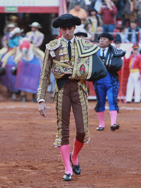 Matador, Bullfighting, Performance, Tradition, Sport venue, Animal sports, Public event, Bullring, Event, Fun,