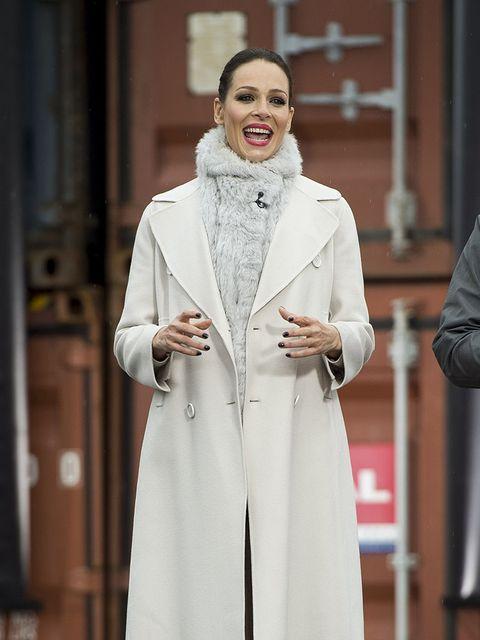 Sleeve, Outerwear, Fashion, Street fashion, Costume design, Fur, Overcoat, Frock coat, Fashion design, Fashion model,