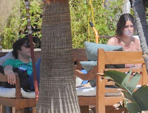 Human, Wood, Leisure, Sitting, Comfort, Trunk, Sunglasses, Beard, Outdoor furniture, Armrest,