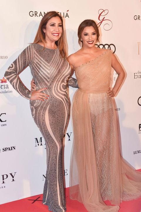 Clothing, Dress, Shoulder, Red carpet, Carpet, Fashion model, Gown, Hairstyle, Flooring, Fashion,