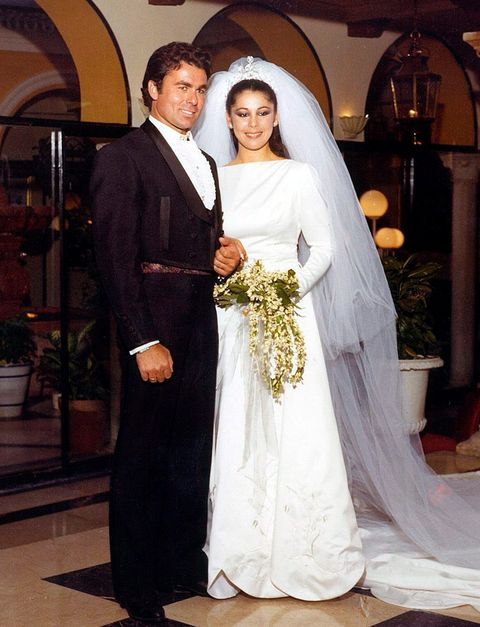 Clothing, Bridal veil, Trousers, Dress, Bridal clothing, Veil, Coat, Wedding dress, Outerwear, Formal wear,