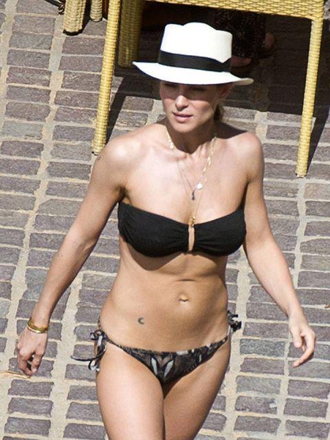 Clothing, Hat, Skin, Brassiere, Joint, Chest, Trunk, Navel, Abdomen, Summer,