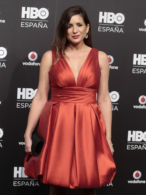 Clothing, Dress, Cocktail dress, Red, Carpet, Fashion model, Red carpet, Orange, Premiere, Hairstyle,