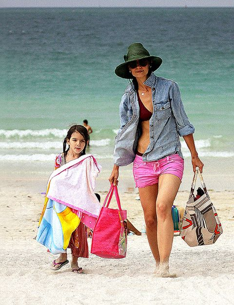 Clothing, Hat, Bag, People on beach, Tourism, Textile, Outerwear, Fashion accessory, Leisure, Summer,