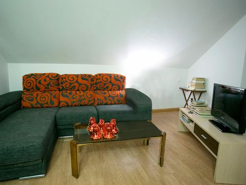 Wood, Room, Brown, Interior design, Green, Wall, Living room, Furniture, Couch, Floor,