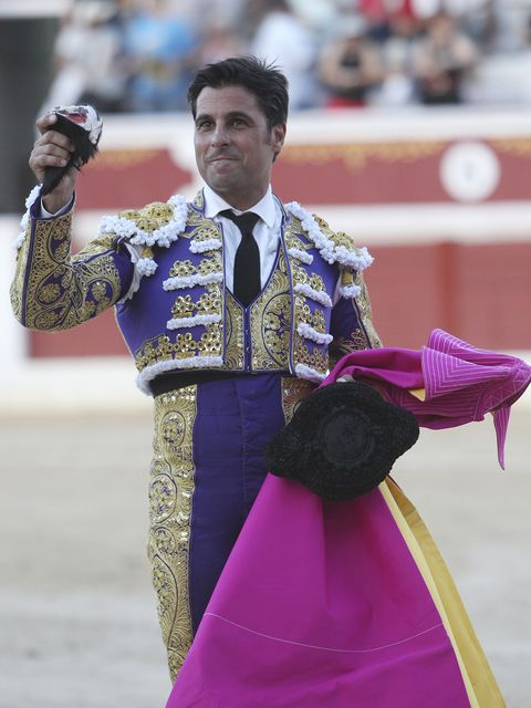 Matador, Bullfighting, Tradition, Performance, Pink, Event, Purple, Animal sports, Public event, Sport venue,