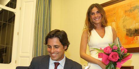 Smile, Petal, Coat, Dress shirt, Happy, Suit, Formal wear, Bouquet, Dress, Tie,