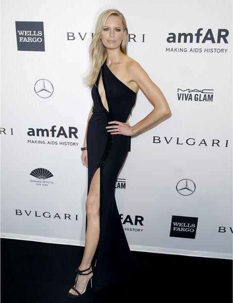 Shoulder, Joint, Human leg, Waist, Dress, Style, High heels, Fashion model, Fashion, Logo,
