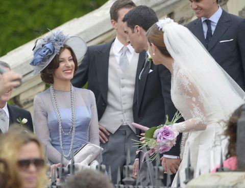 Clothing, Hair, Face, Coat, Bridal veil, Veil, Event, Bridal clothing, Dress, Suit,