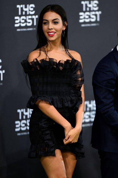 Dress, Style, Fashion model, Eyelash, Fashion, Thigh, Logo, Model, Black hair, Cocktail dress,