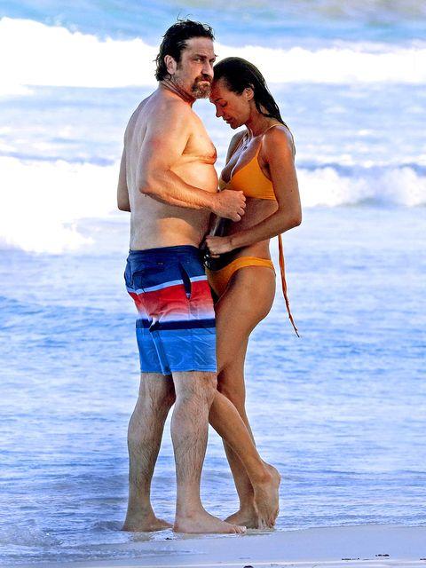 People on beach, Vacation, Honeymoon, Fun, board short, Beach, Trunks, Barechested, Romance, Interaction,