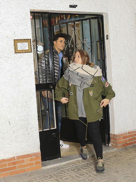 Outerwear, Jacket, Coat, Street fashion, Bag, Luggage and bags, Door, Home door, sweatpant, Handbag,