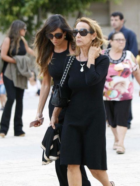 Street fashion, Clothing, Eyewear, Sunglasses, Fashion, Little black dress, Shoulder, Footwear, Dress, Shoe,