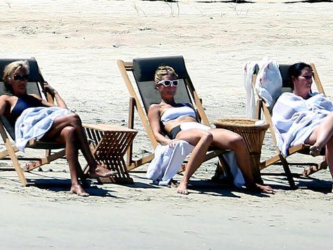 Eyewear, Leg, Human body, Sitting, Leisure, Tourism, Sand, Summer, Barefoot, Vacation,