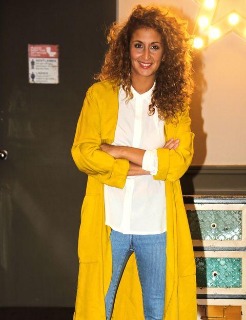Yellow, Sleeve, Jheri curl, Ringlet, Denim, Blazer, Long hair, Suit trousers, Pocket, Fashion design,