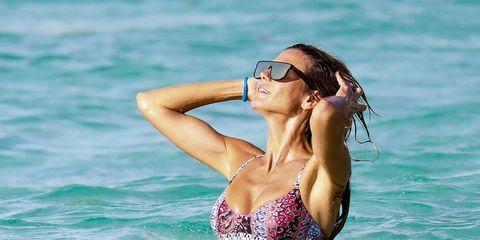 Bikini, Swimwear, Beauty, Vacation, Swimsuit top, Fun, Summer, Model, Photo shoot, Eyewear,