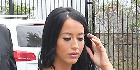 Finger, Hairstyle, Eyebrow, Sleeveless shirt, Automotive tail & brake light, Eyelash, Wrist, Watch, Black hair, Vehicle door,