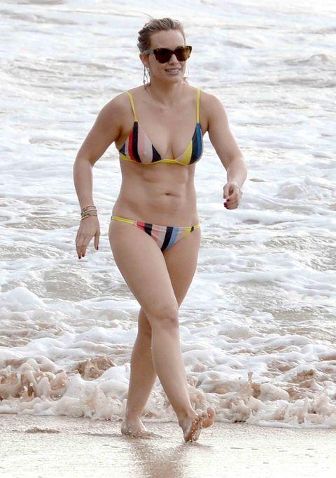 Clothing, Eyewear, Leg, Brassiere, Human body, Swimsuit top, Human leg, Bikini, Swimwear, Swimsuit bottom,