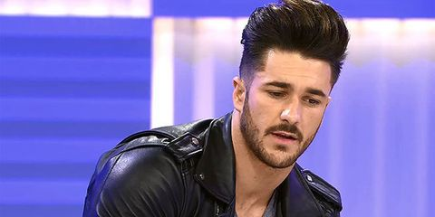 Ear, Jacket, Hairstyle, Collar, Quiff, Black hair, Facial hair, Fashion, Leather jacket, Leather,