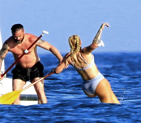 Fun, Vacation, Barechested, Human, Recreation, Muscle, Happy, Leisure, Stand up paddle surfing, Swimwear,
