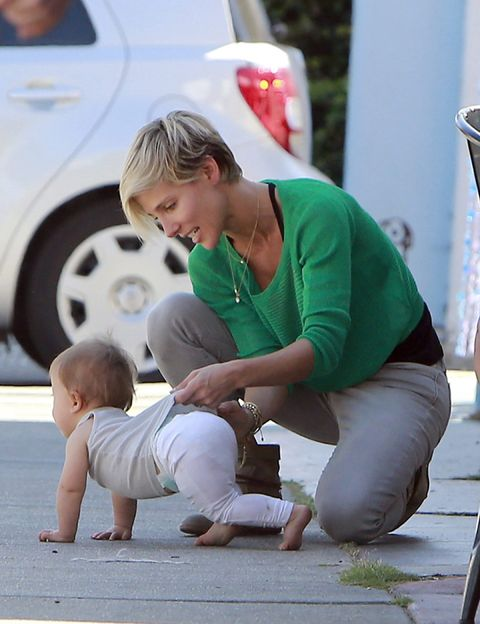 Child, Fender, Baby & toddler clothing, Alloy wheel, Vehicle door, Toddler, Foot, Baby, Active pants, Barefoot,
