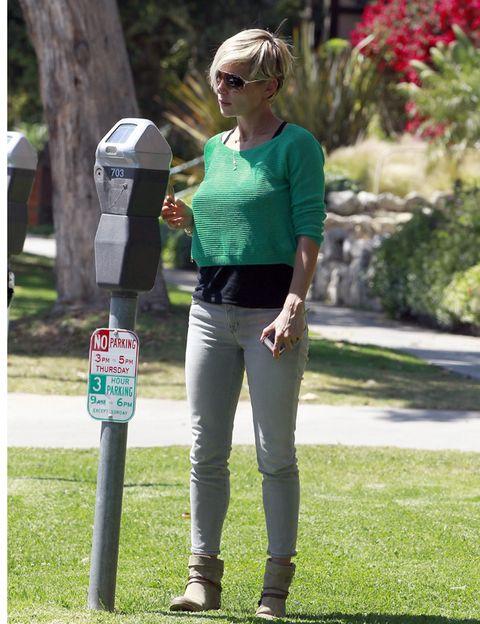 Glasses, Sunglasses, T-shirt, Waist, Street fashion, Riding boot, Goggles, Boot, Active pants, Garden,