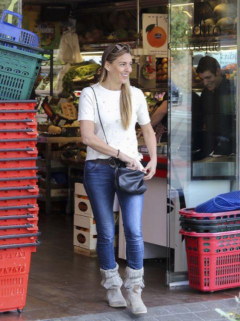 Denim, Trousers, Jeans, Textile, Outerwear, Street fashion, Fashion accessory, Boot, Fashion, Bag,
