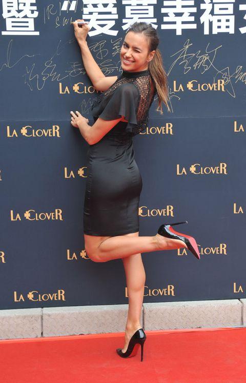 Dress, Flooring, Human leg, Hand, Red, Joint, High heels, Style, Carpet, Little black dress,