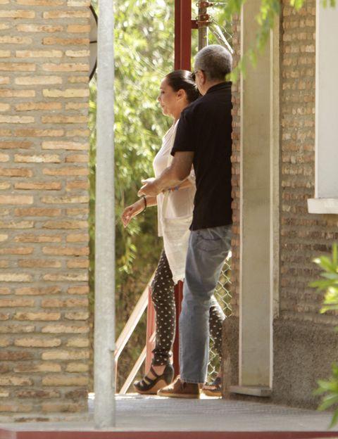 Brick, Interaction, Fixture, House, Brickwork, Romance, Love, Honeymoon, Building material, Gesture,