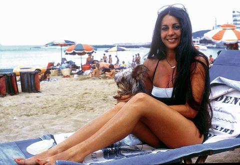 Sun tanning, Bikini, Swimwear, Beach, Beauty, Vacation, Summer, Leg, Fun, Sitting,
