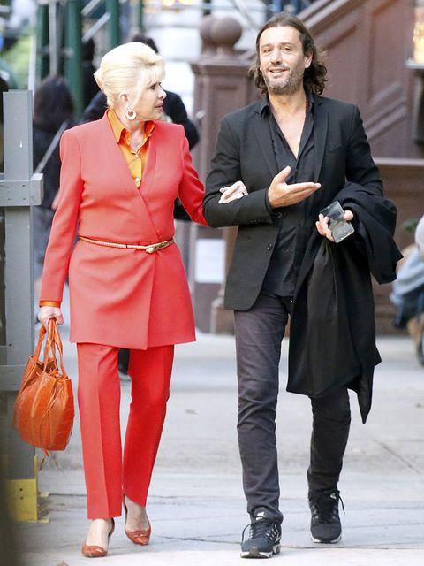 Street fashion, Clothing, Red, Fashion, Snapshot, Orange, Overcoat, Footwear, Outerwear, Human,