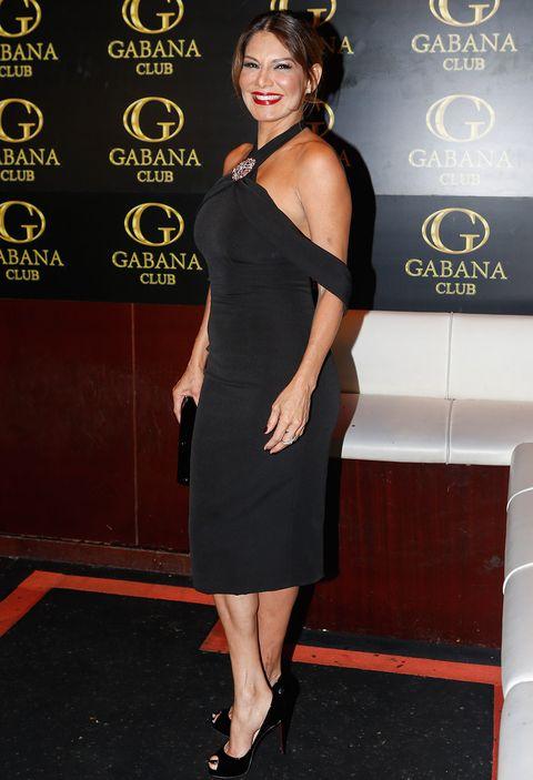 Clothing, Dress, Shoulder, Little black dress, Cocktail dress, Joint, Leg, Premiere, Carpet, Long hair,