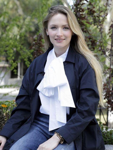 Clothing, Uniform, Outerwear, Blazer, Jacket, Suit, Formal wear, Smile, Photography, Top,