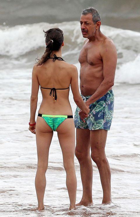 Clothing, Leg, Fun, Skin, Human body, Standing, People on beach, Brassiere, Human leg, People in nature,