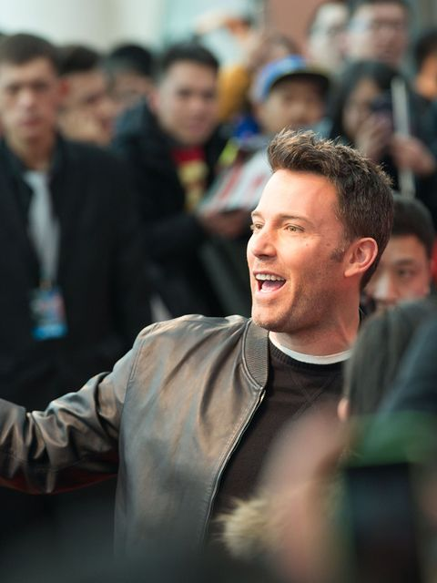 Jacket, Crowd, Facial hair, Leather jacket, Leather, Audience, Laugh, Beard,