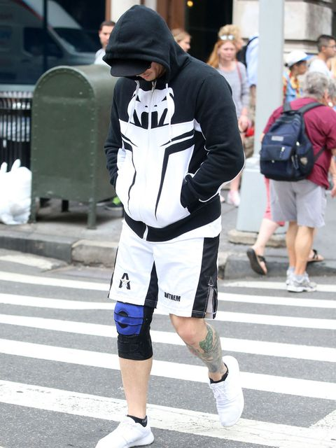 Clothing, Footwear, Leg, Sleeve, Road, Human leg, Pedestrian crossing, Infrastructure, Outerwear, Cap,