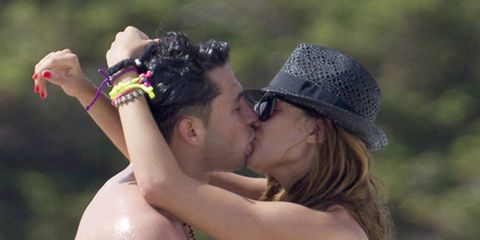 Lip, Skin, Forehead, Photograph, Kiss, People in nature, Fashion accessory, Summer, Romance, Hat,