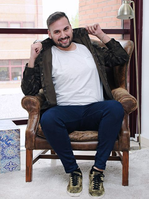 Sitting, Fashion, Facial hair, Footwear, Beard, Human, Jeans, Photography, Shoe, Outerwear,