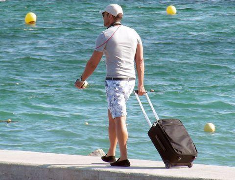 Leg, Human body, Recreation, Water, Elbow, Leisure, Cap, Outdoor recreation, Shorts, Vacation,