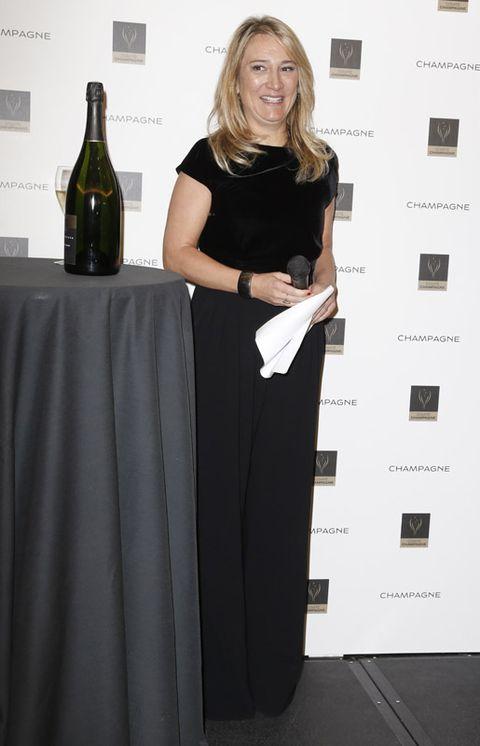 Shoulder, Bottle, Dress, Drink, Glass bottle, Wine bottle, Style, Tablecloth, Formal wear, Drinkware,