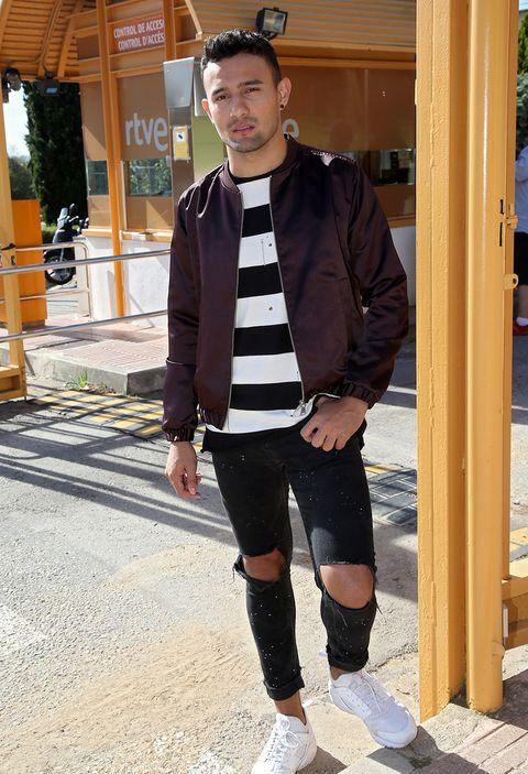 Street fashion, Footwear, Fashion, Standing, Riding boot, Knee, Leg, Outerwear, Jeans, Shoe,