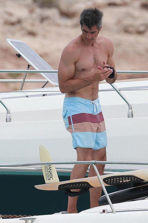 Shoulder, Elbow, Human leg, board short, Chest, Barechested, Shorts, Muscle, Trunks, Bermuda shorts,