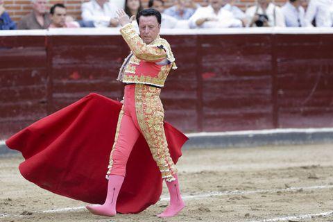 Matador, Bullfighting, Sport venue, Animal sports, Bullring, Bull, Performance, Tradition, Bovine, Public event,