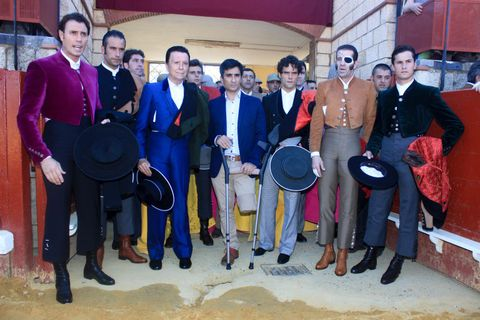 Footwear, Hat, Membranophone, Sun hat, Conversation, Percussion, Musical ensemble, Drum, Fedora, Drumhead,