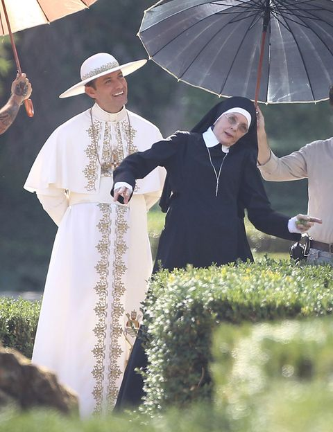 Hat, Tradition, Costume accessory, Umbrella, Costume design, Costume, Ceremony, Clergy, Ritual, Costume hat,