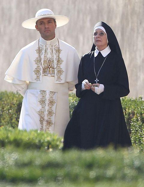 Headgear, Tradition, Temple, Cloak, Clergy, Vestment, Religious institute, Abaya, Religious item, Ritual,