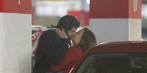 Red, Automotive tail & brake light, Interaction, Kiss, Windshield, Trunk, Automotive window part, Vehicle door, Love, Back,