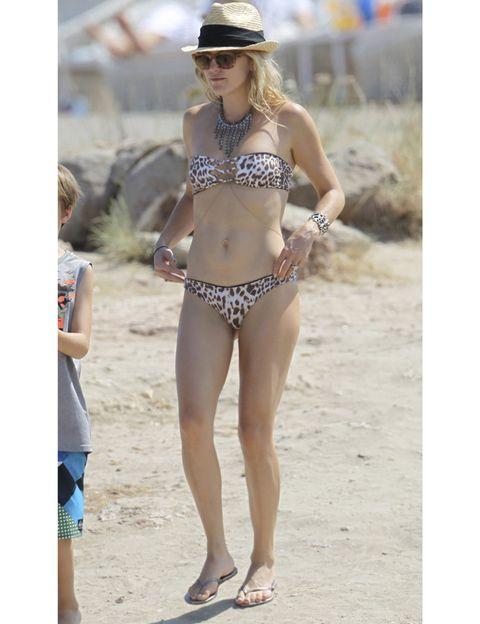 Clothing, Brassiere, Leg, Hat, Human leg, Swimsuit top, Joint, Bikini, Summer, Swimwear,