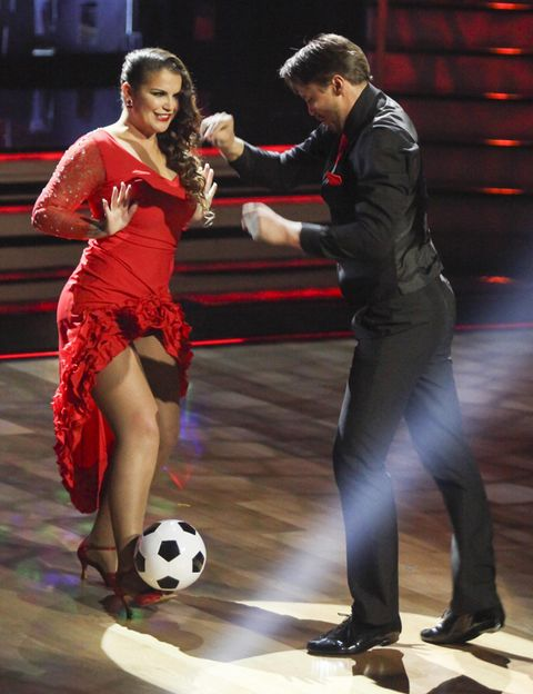 Ball, Football, Soccer ball, Performing arts, Ball, Soccer, Stage, Soccer player, Dance, Shelf,
