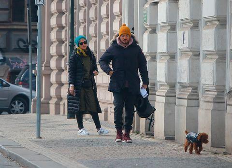 Outerwear, Coat, Street fashion, Street, Jacket, Winter, Alloy wheel, Sidewalk, Auto part, Walking,
